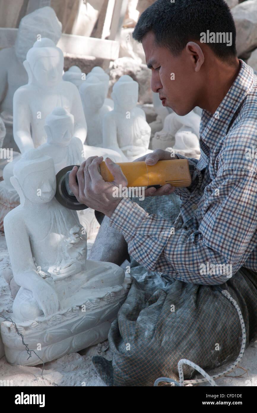 Man carving Buddha in white stone, Mahamuni pagoda, Mandalay, Myanmar, Asia - Stock Image