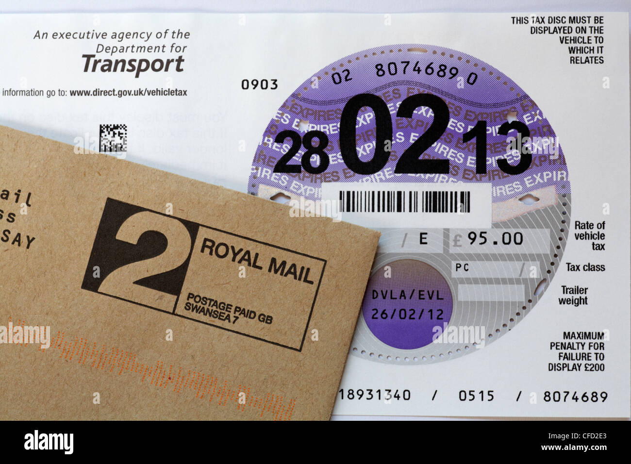 new car tax received in post with envelope - Stock Image