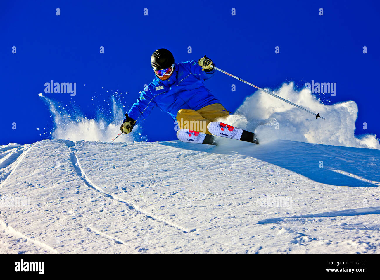 Skier on the upper slopes of Whistler Mountain, Whistler Blackcomb, Whistler, British Columbia, Canada. - Stock Image
