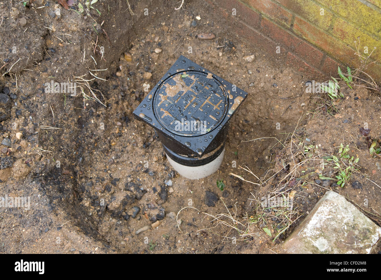 Domestic water main sunk into the ground - Stock Image