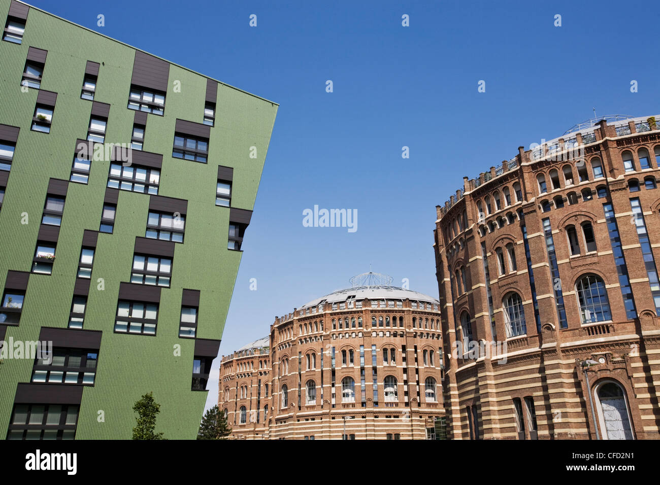 Green residential apartments and converted gasometers, Gasometer City, Simmering, Vienna, Austria, Europe - Stock Image
