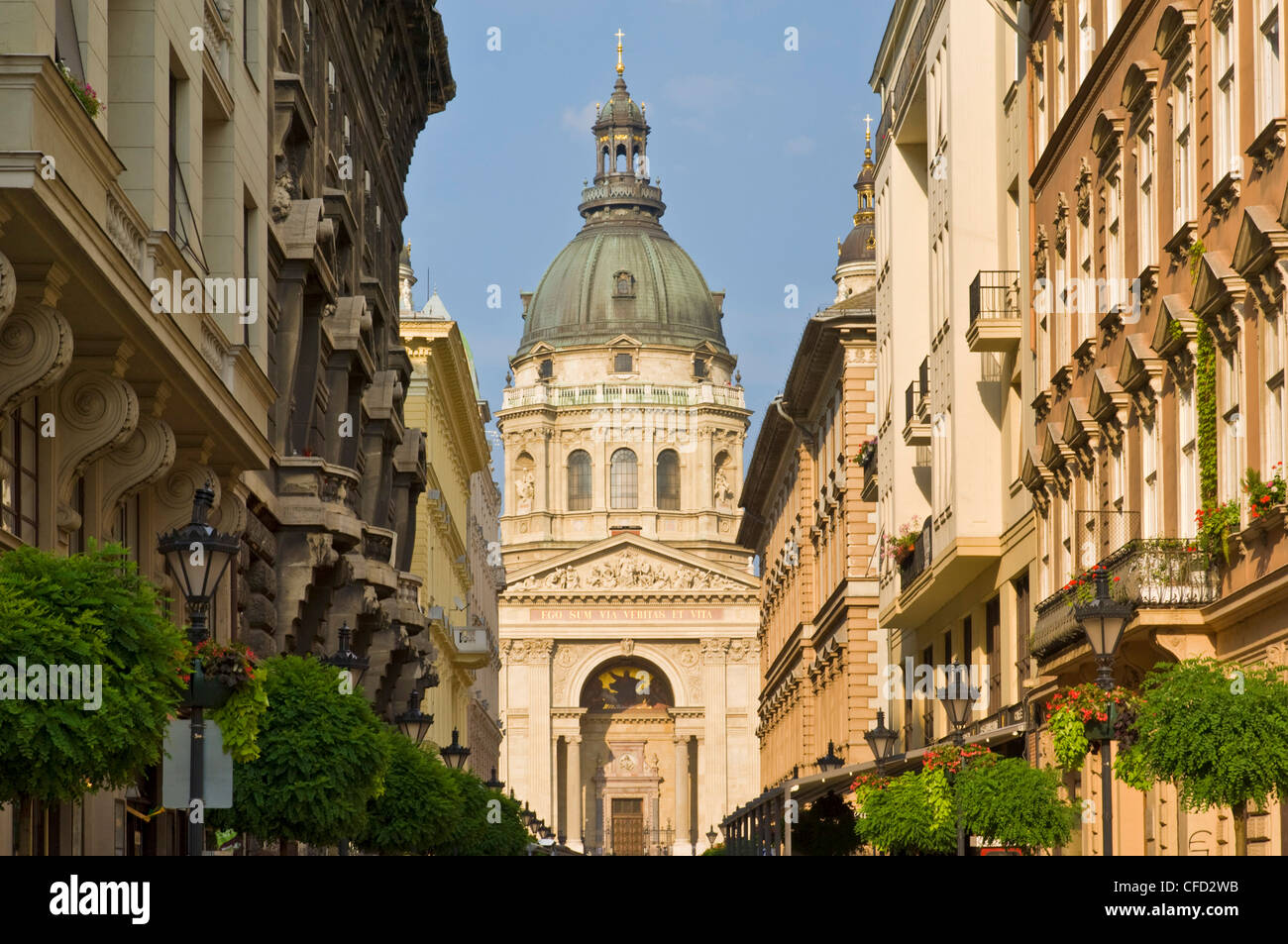 The neo-renaissance dome of St. Stephen's Basilica, shops and buildings of the Zrinyi Utca, central Budapest, - Stock Image