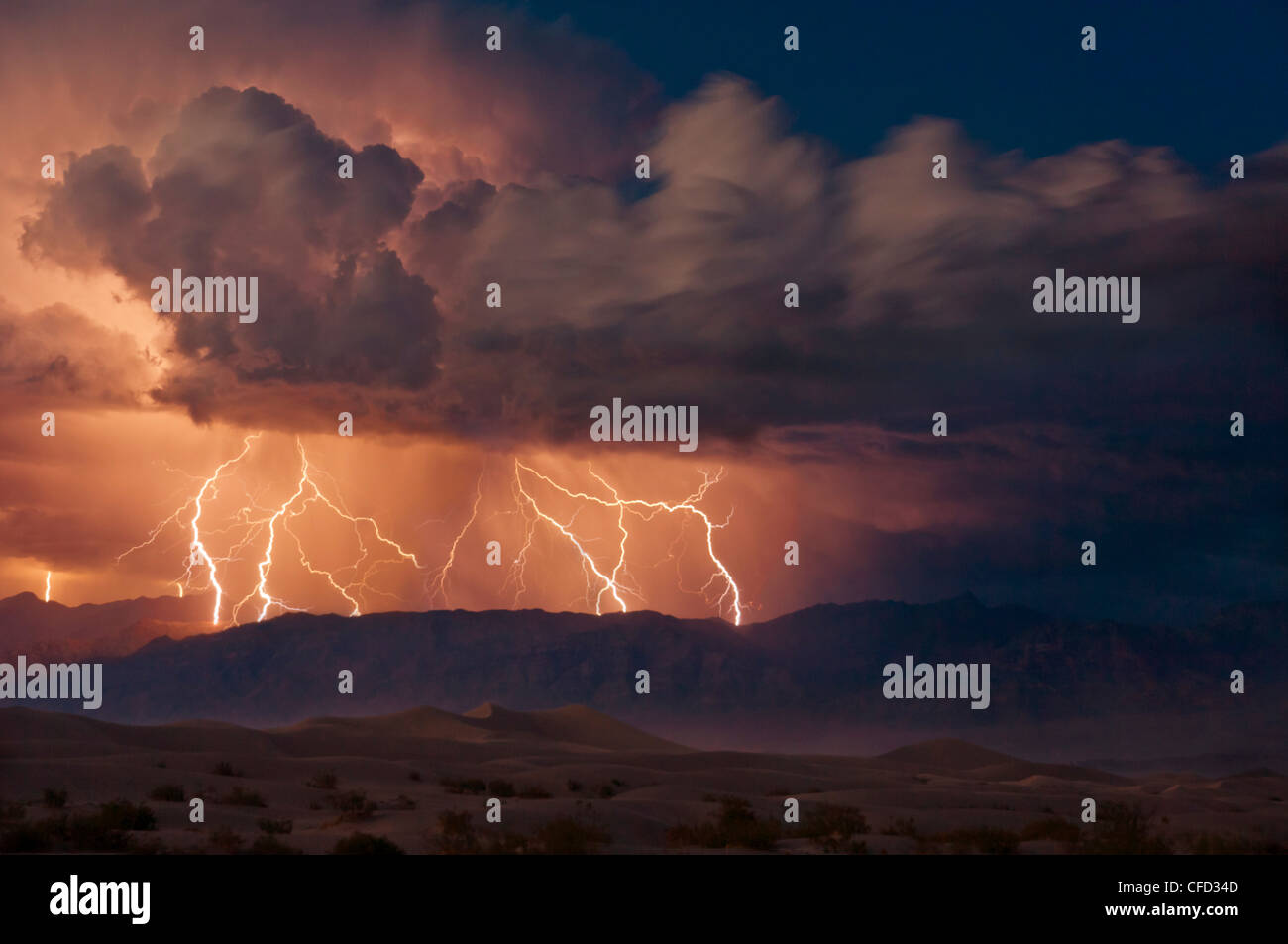 Electrical storm over the Amargosa Range, Mesquite Flats, Stovepipe Wells, Death Valley National Park, California, - Stock Image