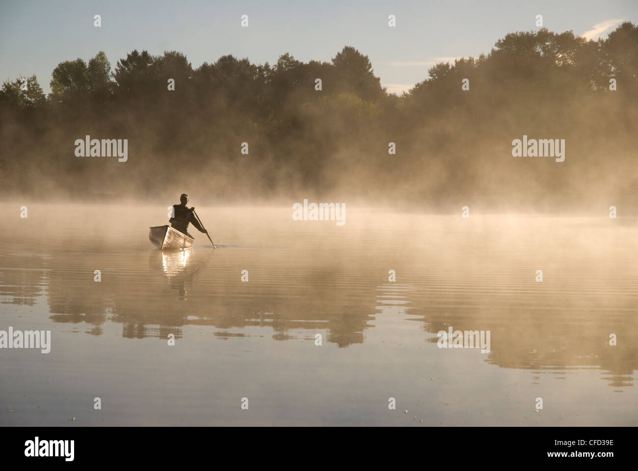 Solo Paddler on the Severn River in Muskoka, Ontario, Canada - Stock Image