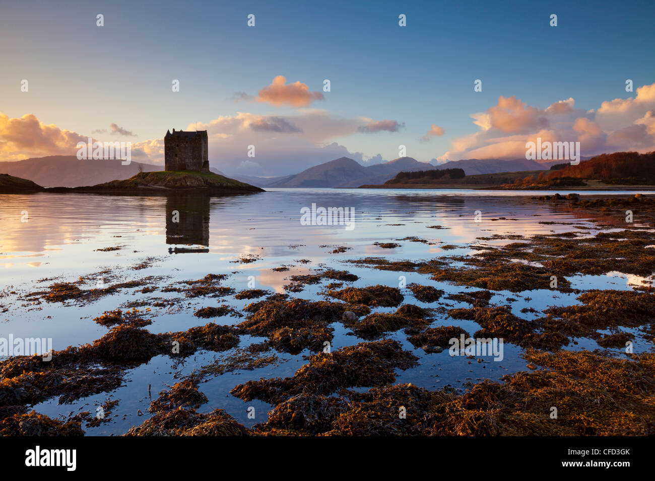 Silhouette of Castle Stalker, a Tower House,Keep, Loch Laich, Port Appin, Argyll, Highlands, Scotland, UK - Stock Image