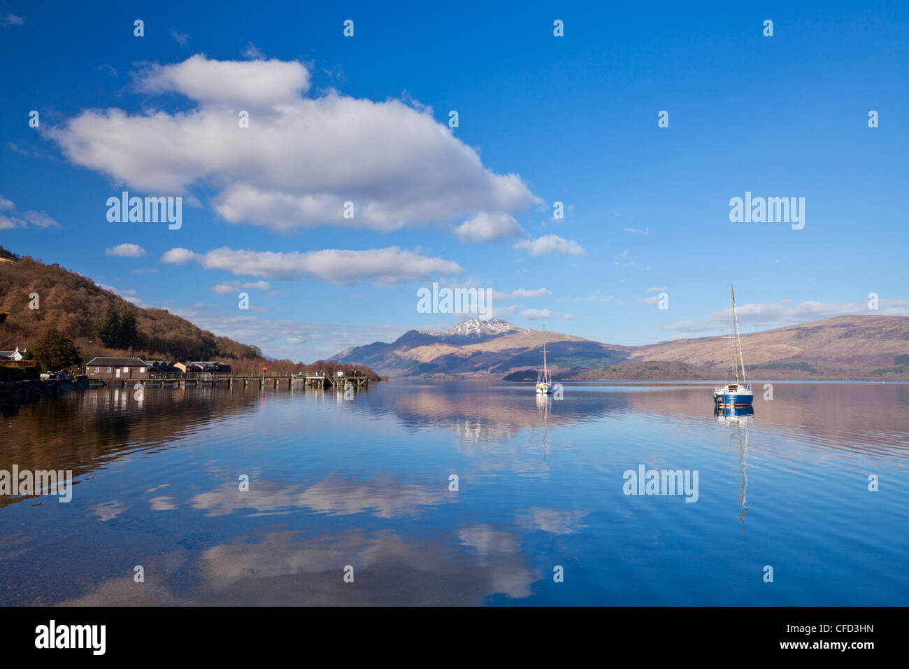 Picturesque tranquil Loch Lomond with sailing boats, Luss Jetty, Luss, Argyll and Bute, Scotland, United Kingdom, - Stock Image