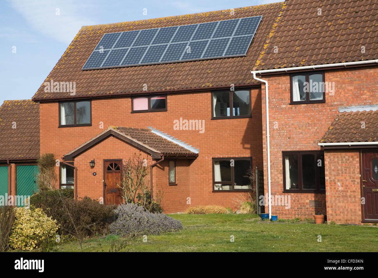 Solar panels of roof domestic property, Martlesham, Suffolk, England - Stock Image