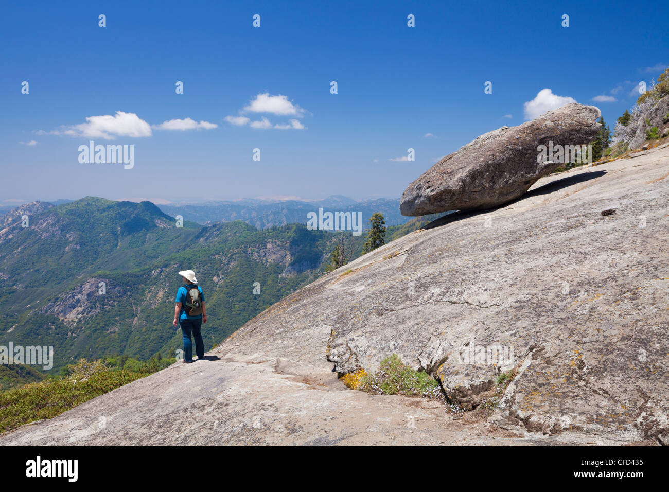 Tourist hiker, at Hanging rock, Tulare County, Sequoia National Park, Sierra Nevada, California, USA - Stock Image