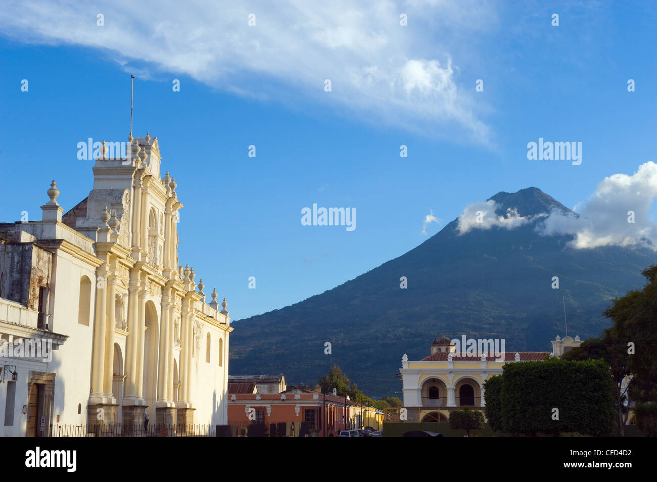 Volcan de Agua, 3765m, and Cathedral, Antigua, UNESCO World Heritage Site, Guatemala, Central America - Stock Image