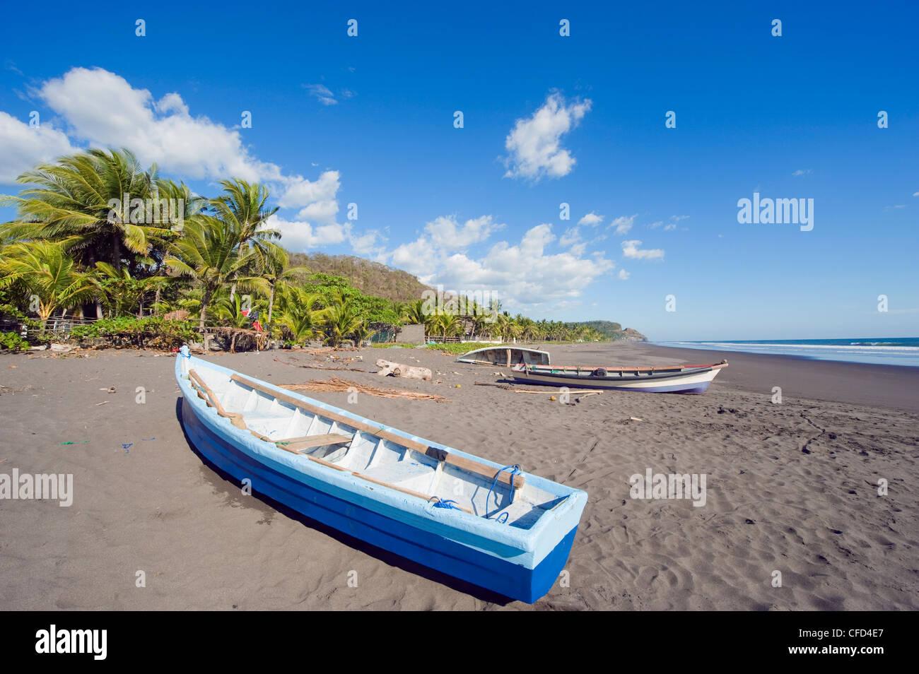 Fishing boats on the beach at Playa Sihuapilapa, Pacific Coast, El Salvador, Central America Stock Photo