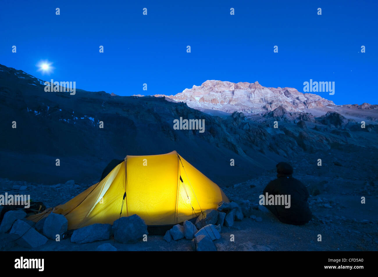 Illuminated tent at Plaza de Mulas base camp, Aconcagua, Aconcagua Provincial Park, Andes mountains, Argentina - Stock Image