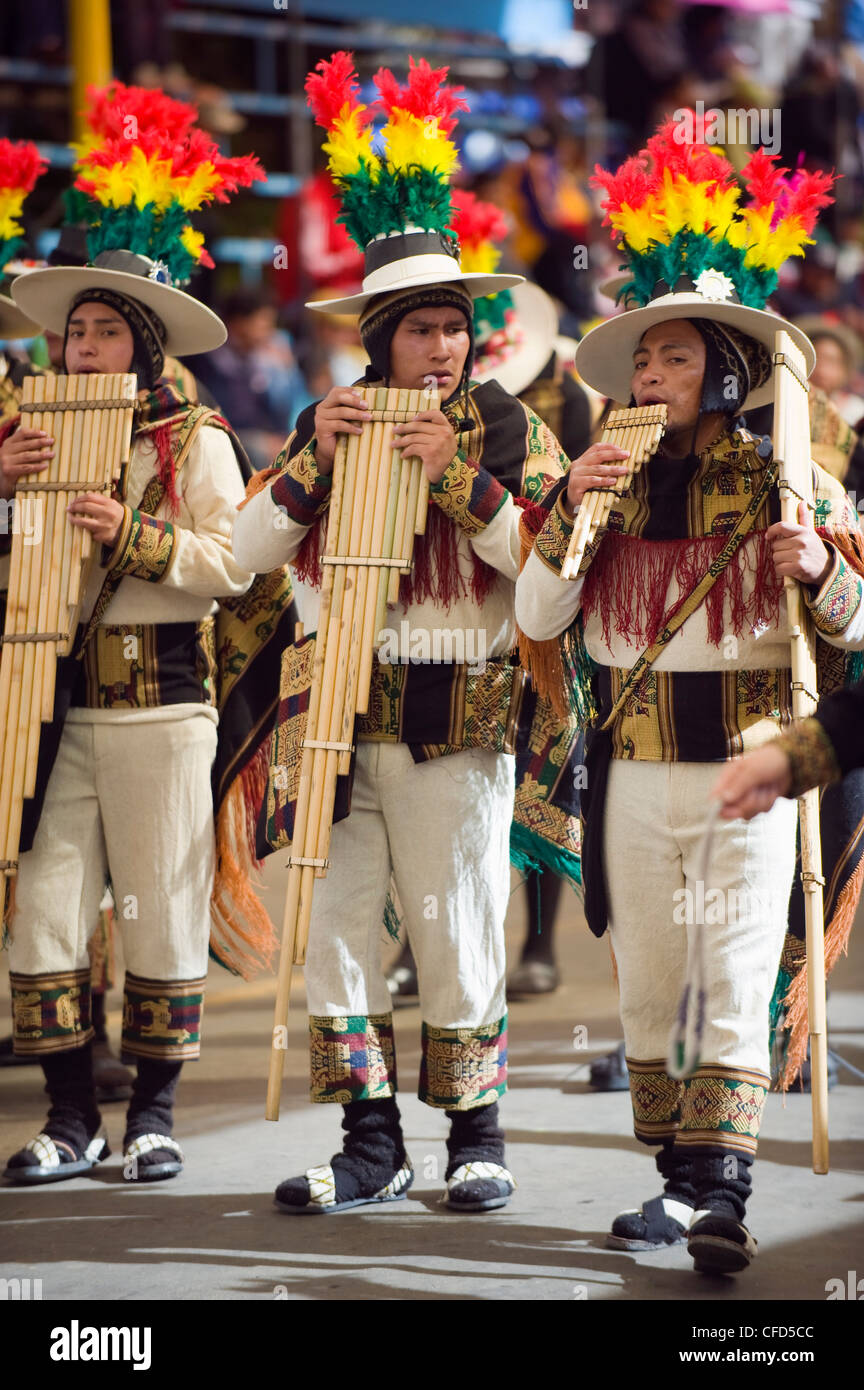Musicians playing the flute during Oruro Carnival, Oruro, Bolivia, South America - Stock Image