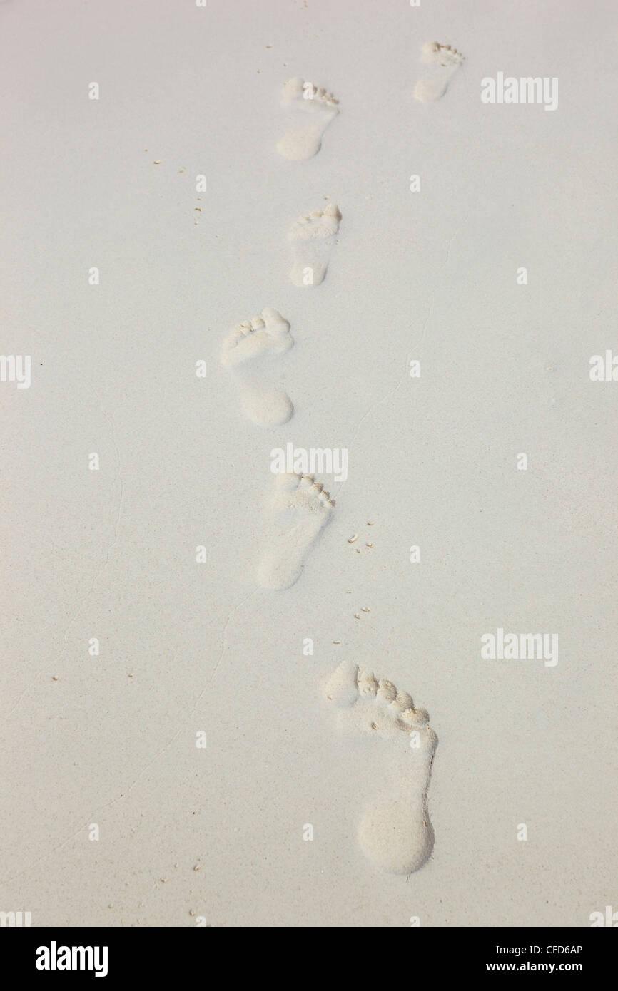 Footpints on fine white sand, Similan Islands, Andaman Sea, Thailand - Stock Image