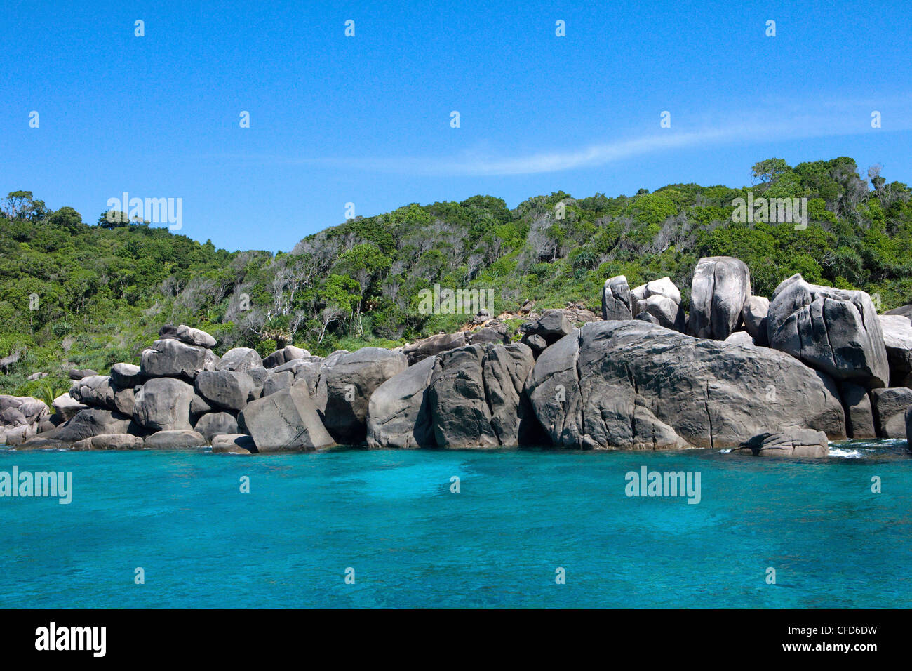 View onto rocks and rainforest on an island, Similan Islands, Andaman Sea, Thailand - Stock Image