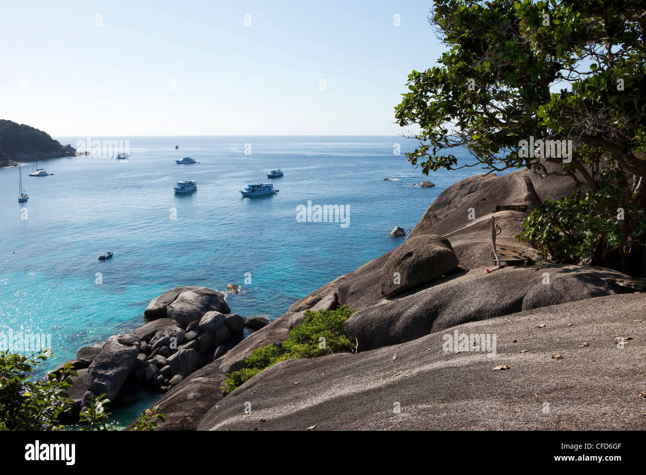 View from the top of Sail Rock down onto the sea with diving boats, Similan Islands, Andaman Sea, Thailand - Stock Image