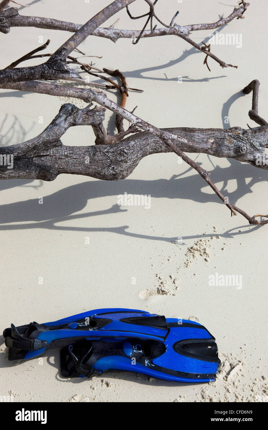 Snorkling fins lying on tropical beach, Similan Islands, Andaman Sea, Thailand - Stock Image