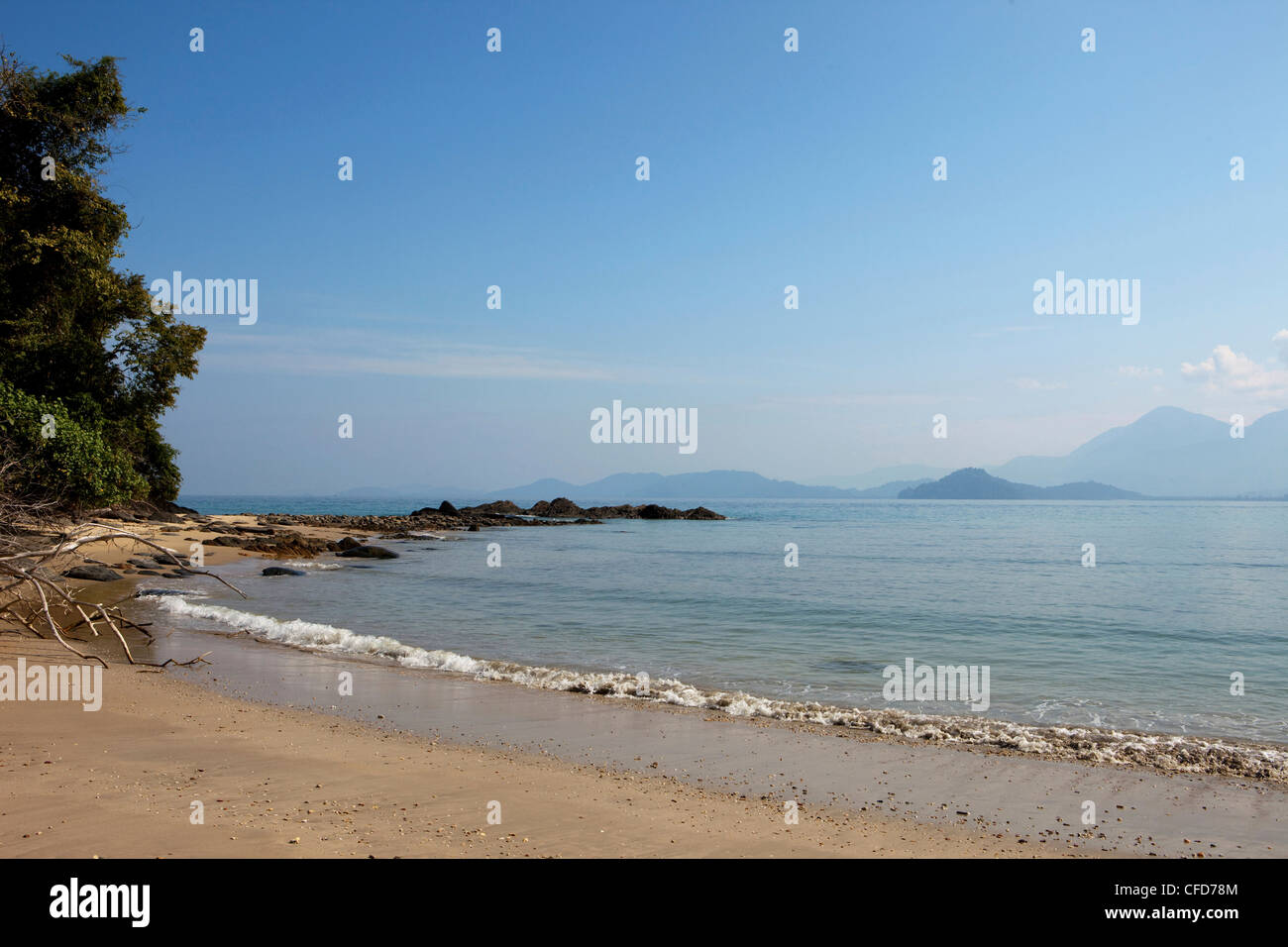 Beach of Koh Ra eco lodge with a view over to the mainland, Koh Ra, Andaman Sea, Thailand - Stock Image