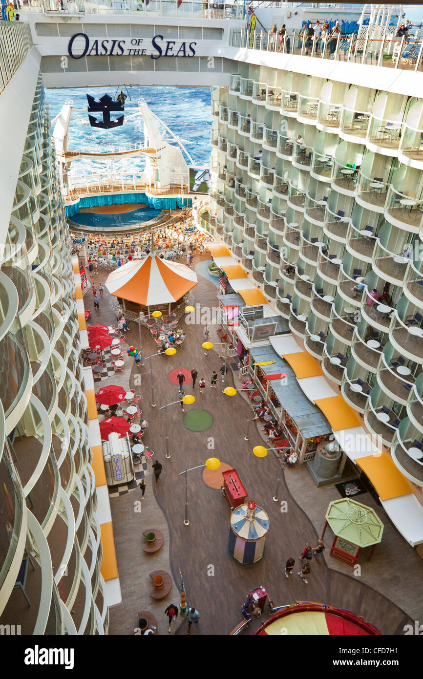 One of seven 'neighbourhoods' on Royal Caribbean's Oasis of the Seas cruise ship, the Boardwalk. - Stock Image