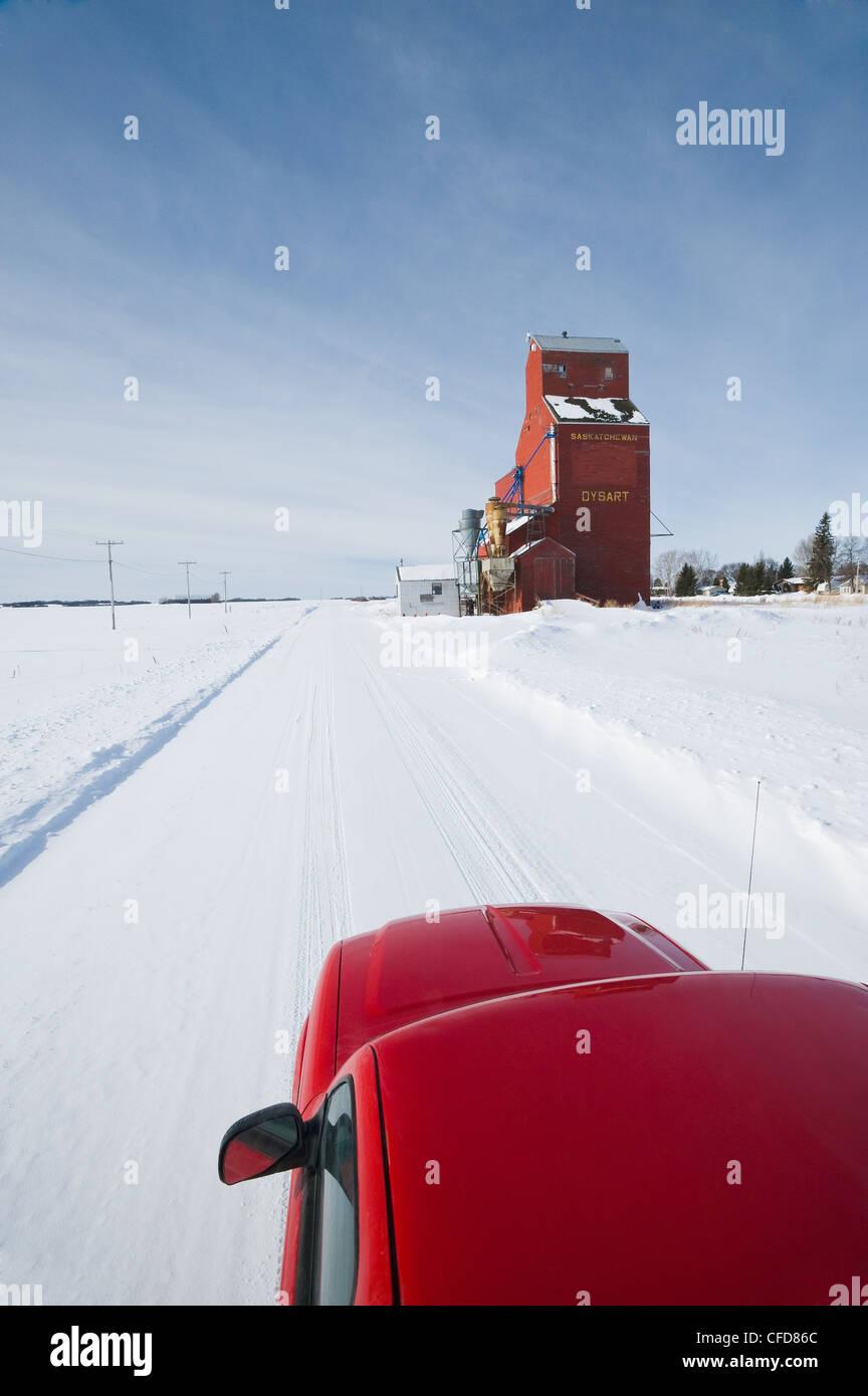 Pick up truck on road, old grain elevator, Dysart, Saskatchewan, Canada Stock Photo