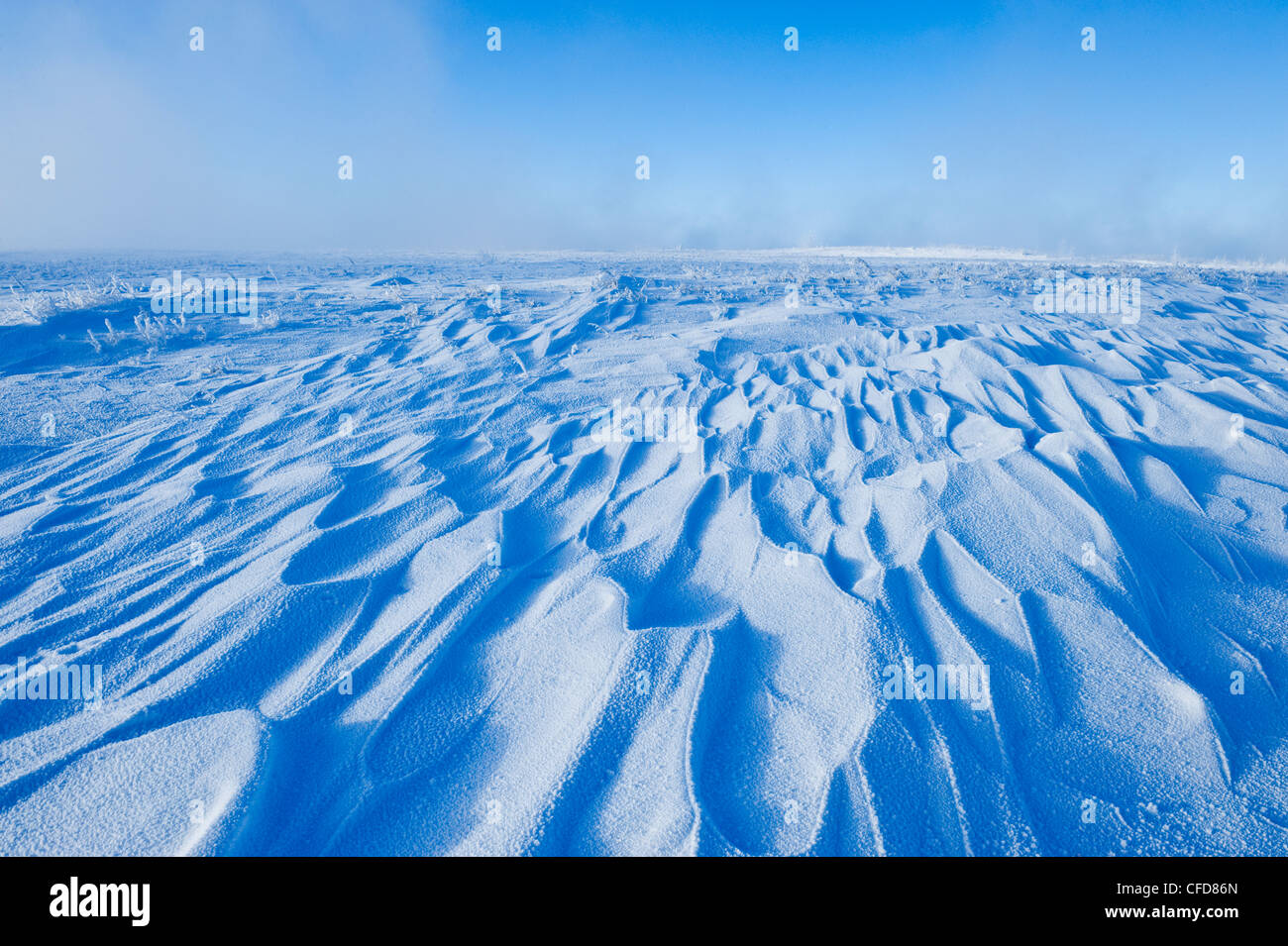Snow drifts caused by wind, Southern Saskatchewan, Canada - Stock Image