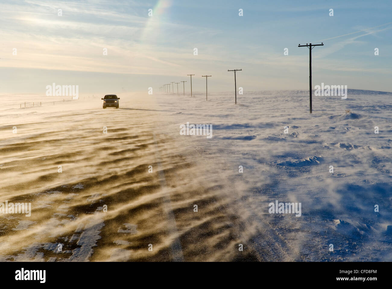 Road covered with blowing snow, near Verwood, Saskatchewan, Canada - Stock Image