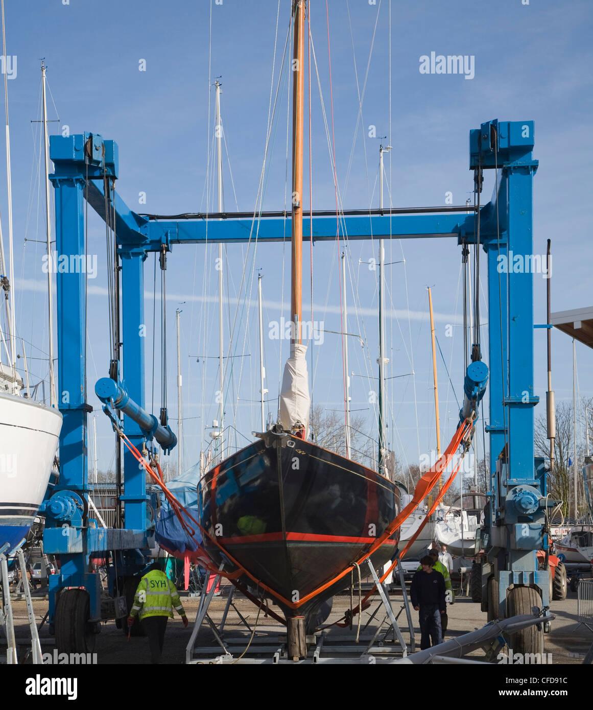 Boatyard and boat crane Levington marina, Suffolk, - Stock Image