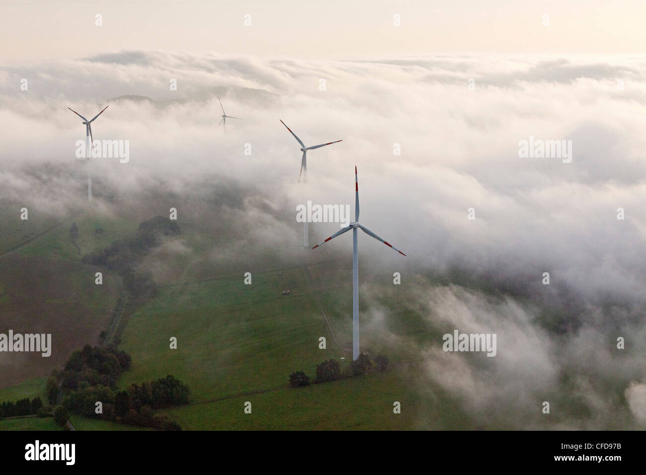Aerial view of wind wheels at a wind turbine park in the fog, Eifel, Rhineland Palatinate, Germany, Europe - Stock Image
