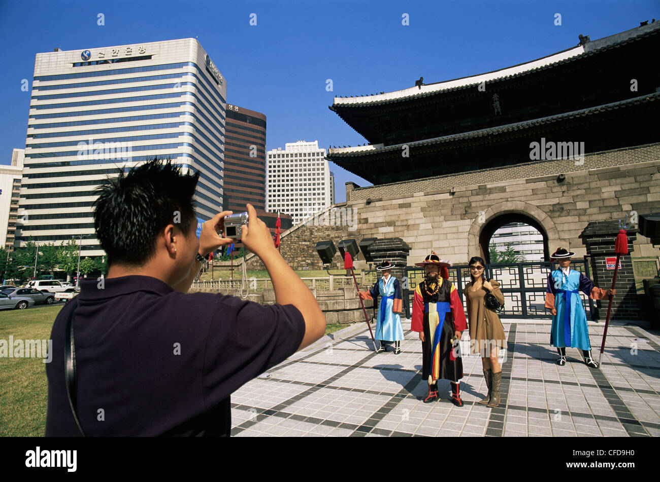 Korea, Seoul, Sungnyemun, South Gate, Asian Tourist Couple Taking Photos of  Ceremonial Guards in Front of Sungnyemun Gate