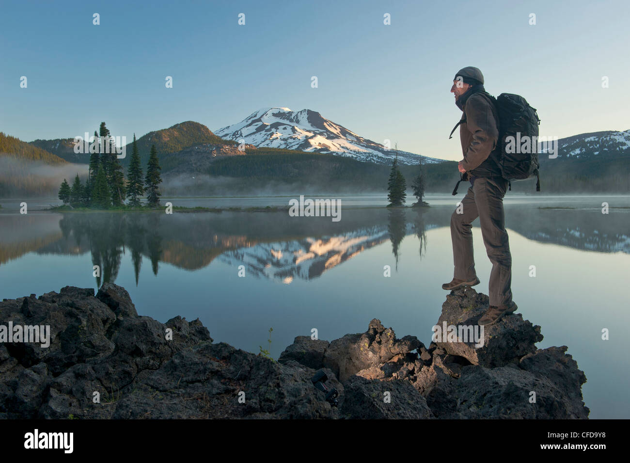 Man with backpack hiking, Sparks Lake in the morning. Stock Photo