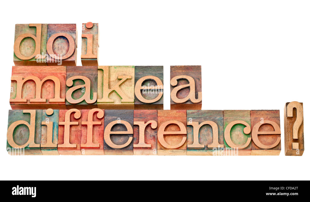 Do I make a difference? A question in vintage wooden letterpress printing blocks isolated on white. - Stock Image
