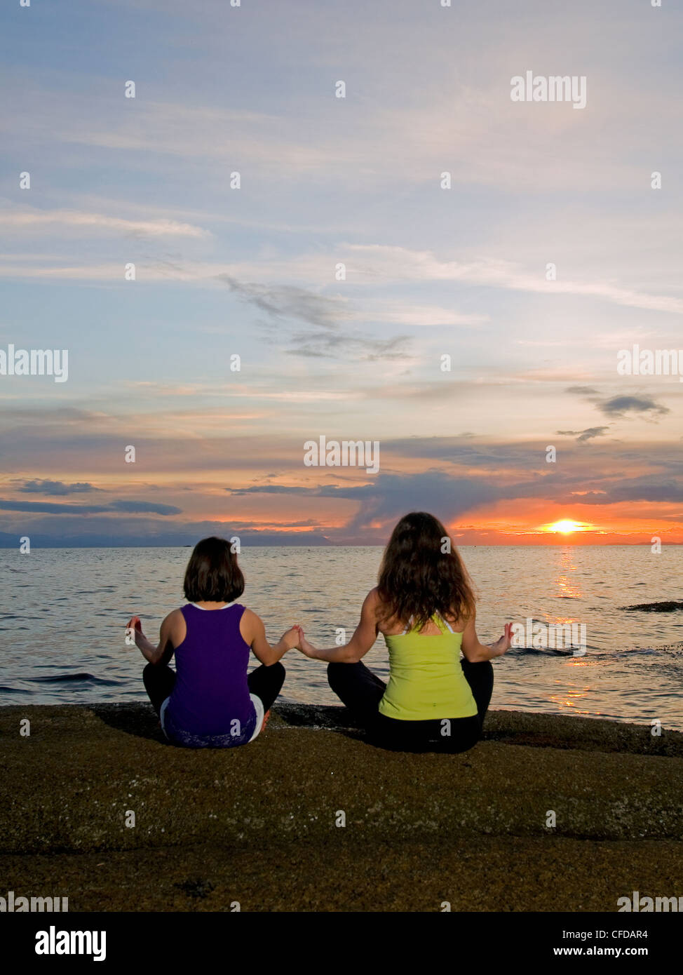 mother daughter spend time practicing yogon - Stock Image