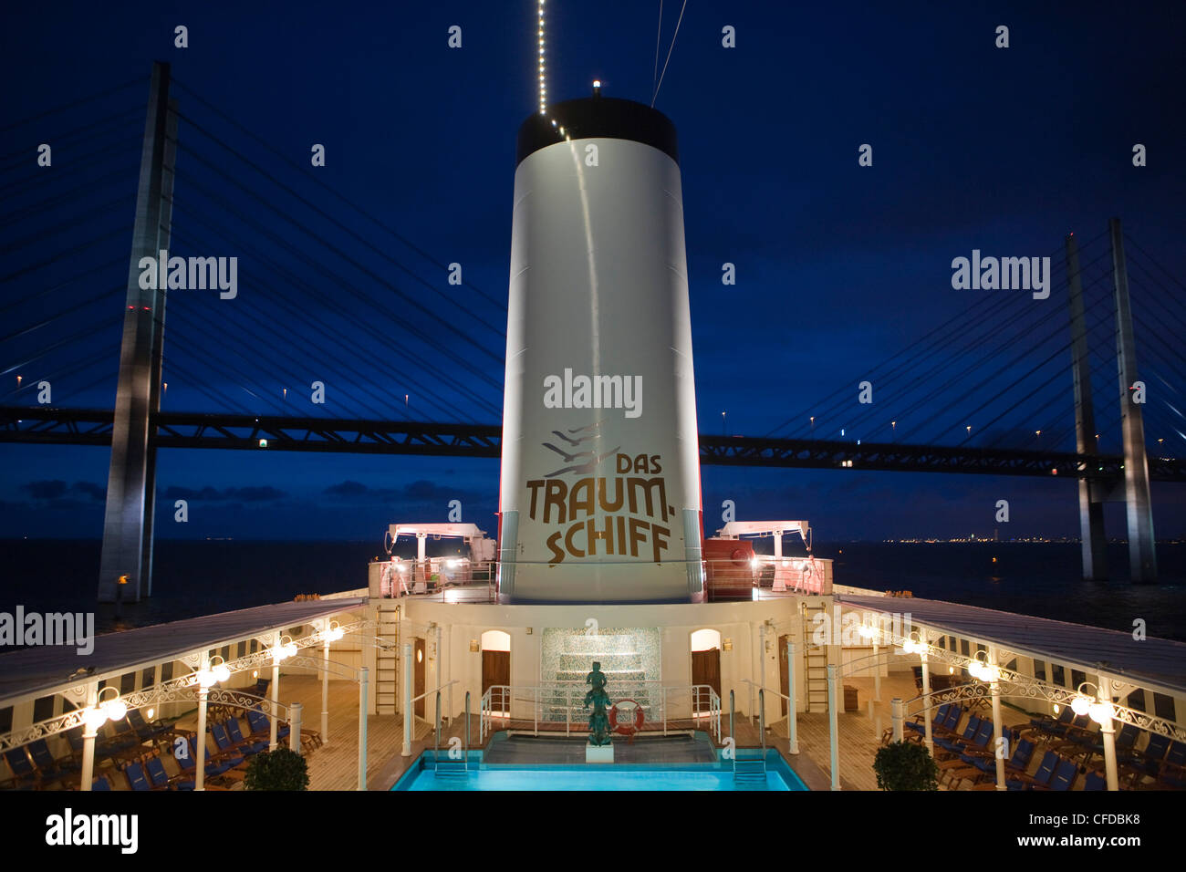 Pool and funnel of cruiseship MS Deutschland (Reederei Peter Deilmann) in the evening after passing beneath the - Stock Image