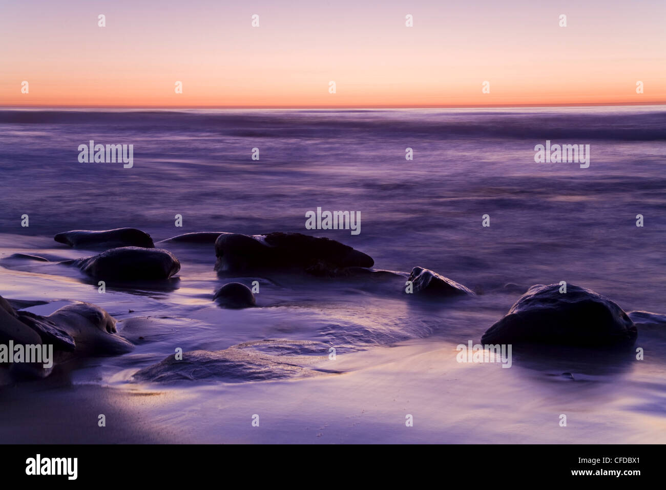 Rocks and beach at sunset, La Jolla, San Diego County, California, United States of America, - Stock Image