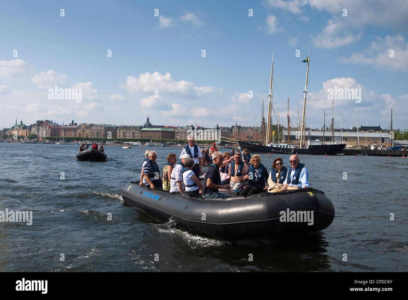 Zodiac excursion from cruiseship MS Deutschland (Reederei Peter Deilmann) through Stockholm canals, Stockholm, Sweden - Stock Image