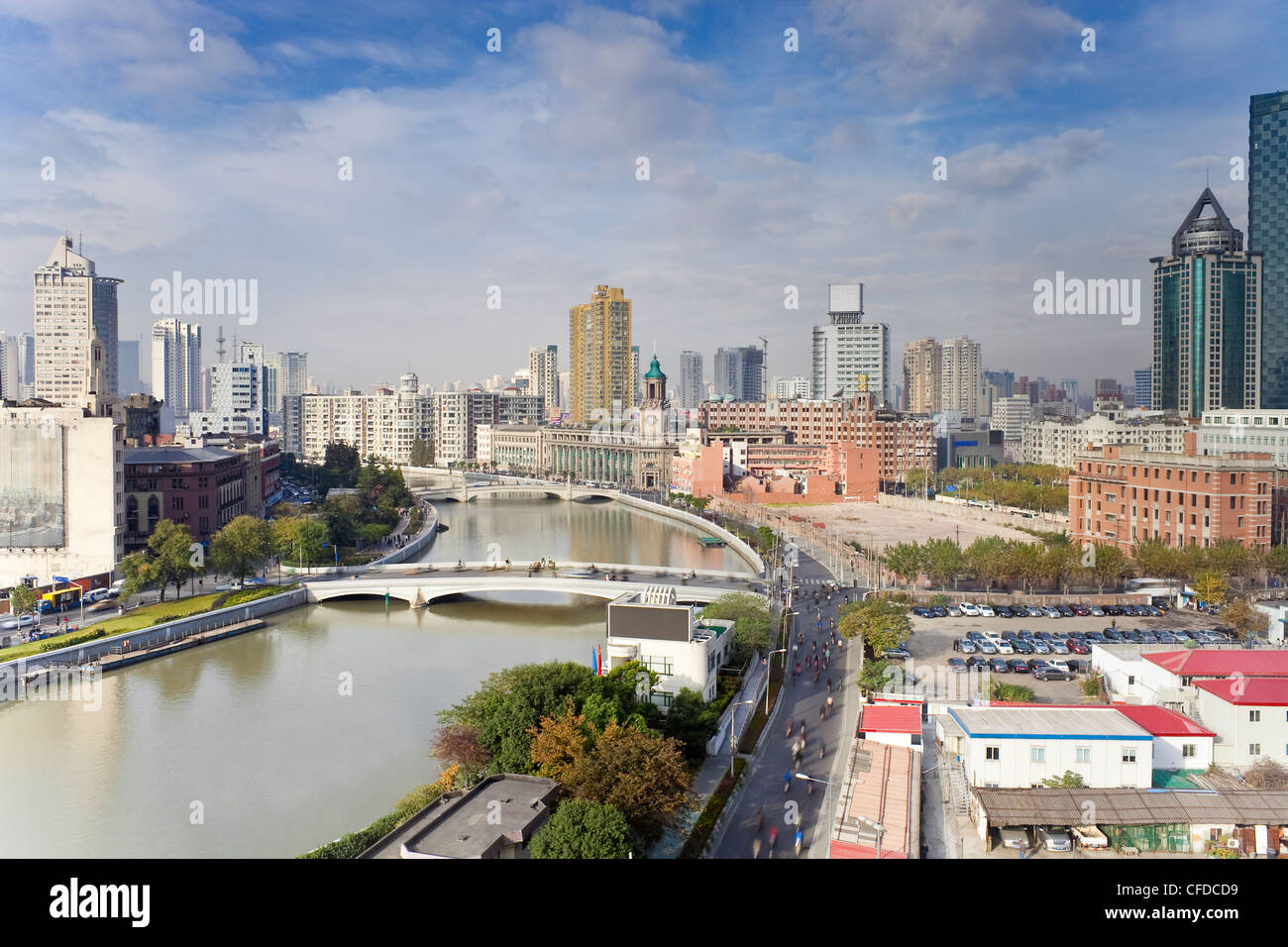 Elevated view along Suzhou Creek, new bridges and city skyline, Shanghai, China, Asia - Stock Image