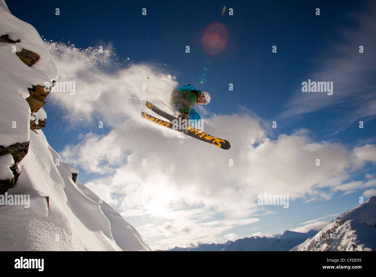A young male skier airs a cliff in the kicking horse backcountry, Golden, Britsh Columbia, Canada Stock Photo