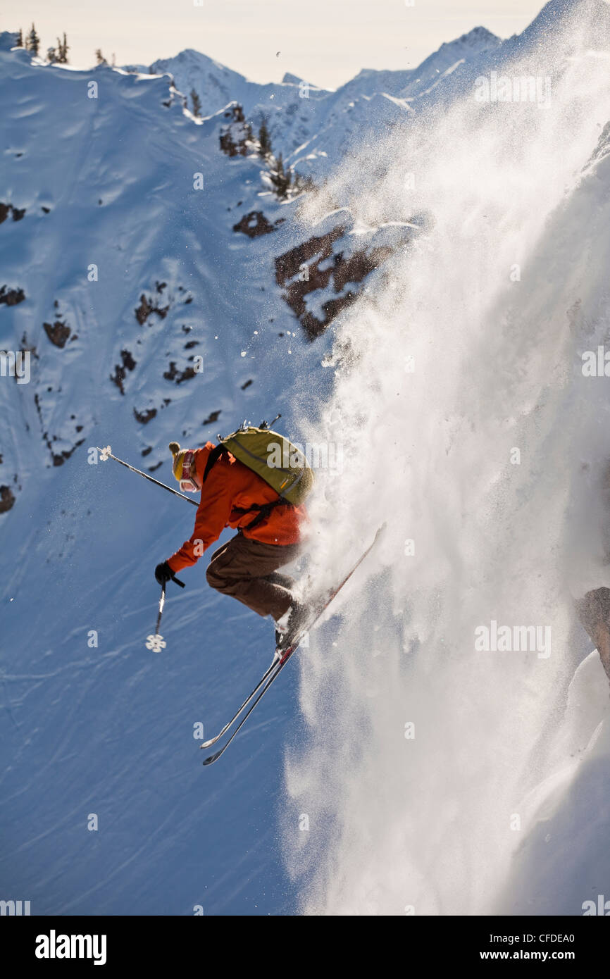 A young male skier airs a cliff in the kicking horse backcountry, Golden, Britsh Columbia, Canada - Stock Image