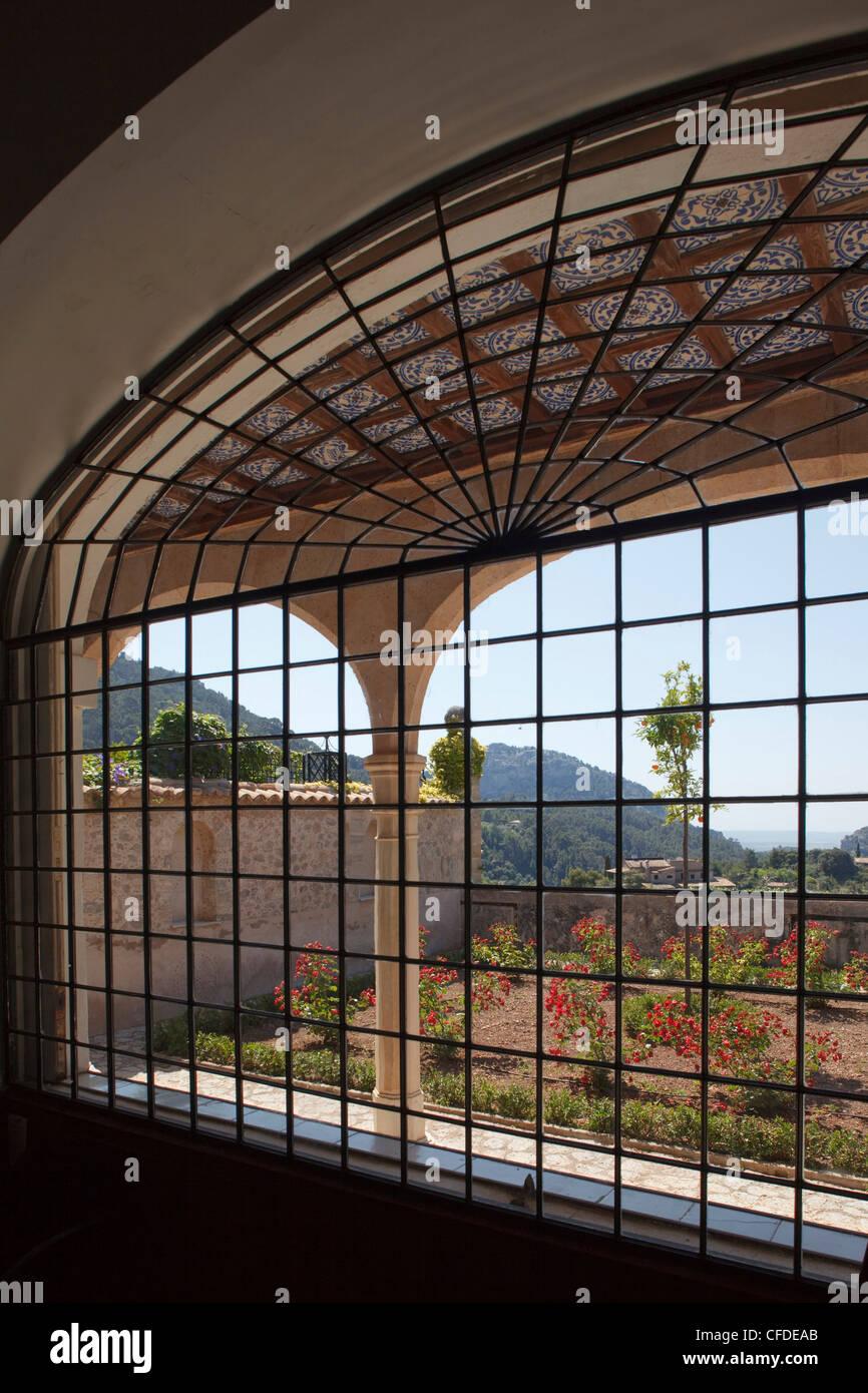 View out of a window at the monastery Sa Cartoixa, La Cartuja, Valldemossa, Tramuntana mountains, Mallorca, Balearic - Stock Image
