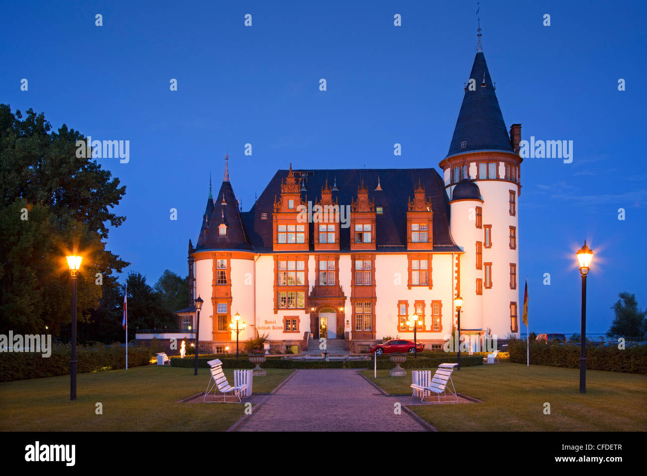 Hotel castle Klink in the evening, Mueritz, Mecklenburg lake district, Mecklenburg Western-Pomerania, Germany, Europe - Stock Image
