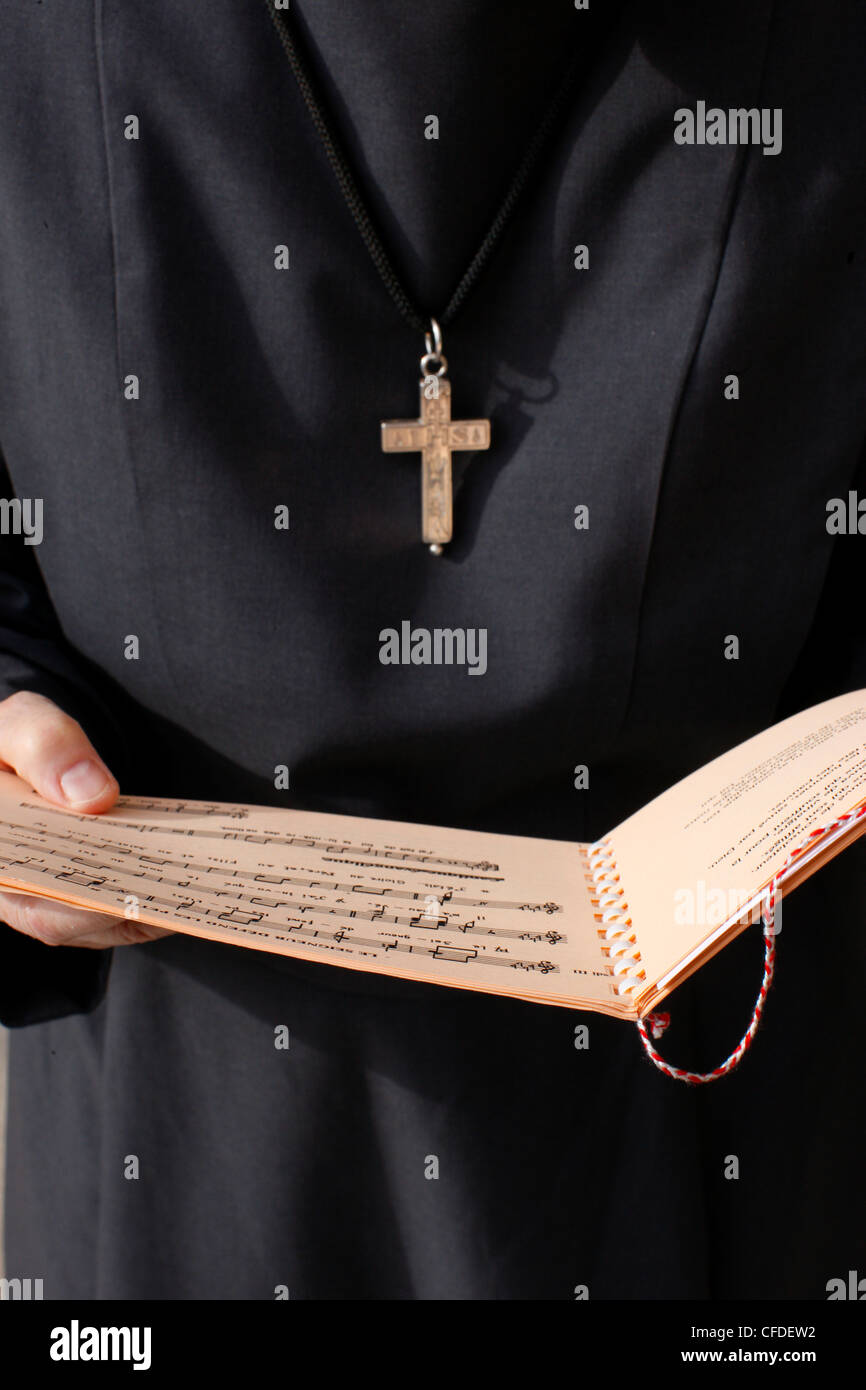 Catholic nun holding a music sheet, Annecy, Haute-Savoie, France, Europe - Stock Image