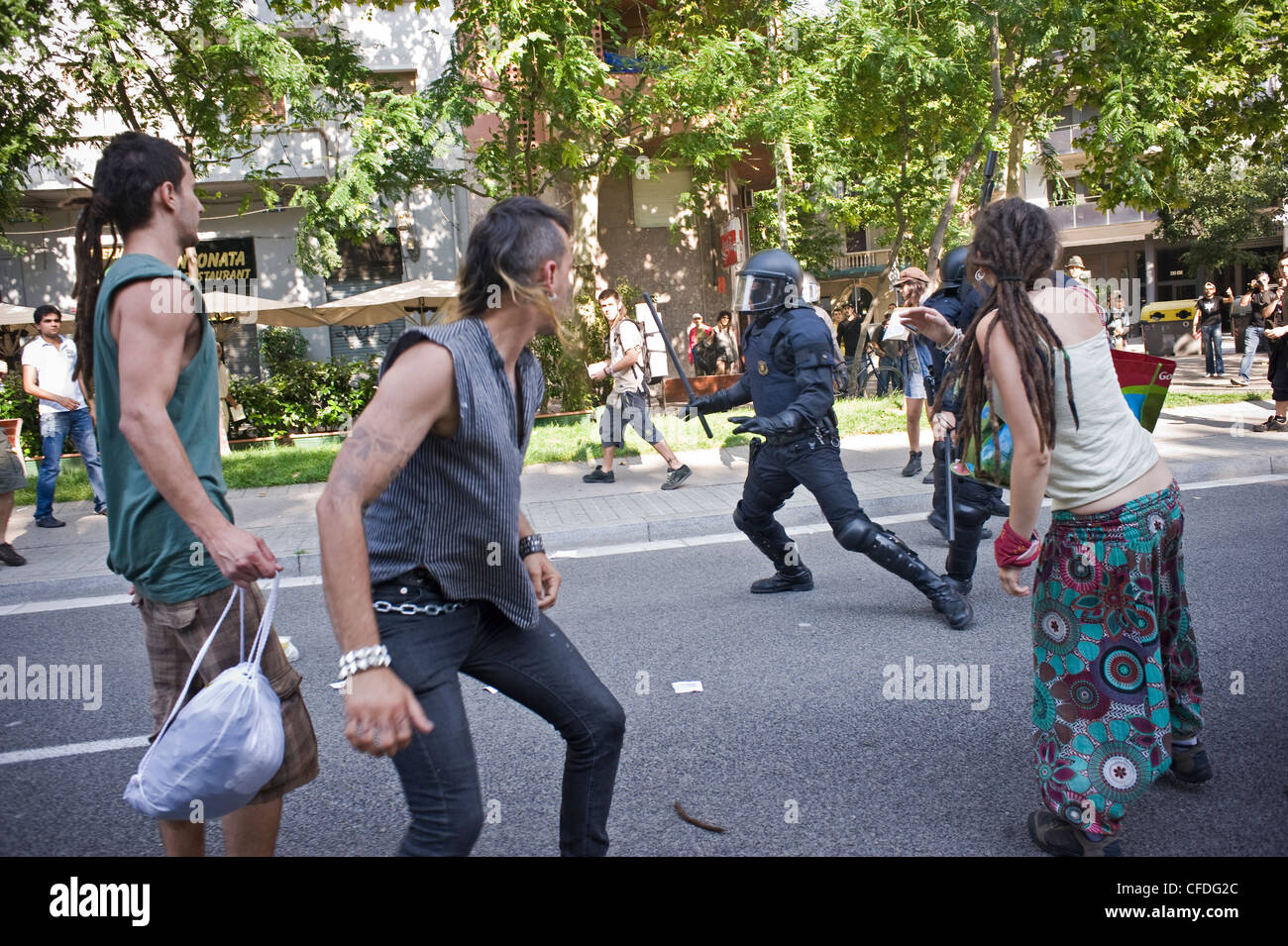 Protest of the indignants (spanish revolution) and clashes with police in Barcelona near the Catalan Parliament, - Stock Image