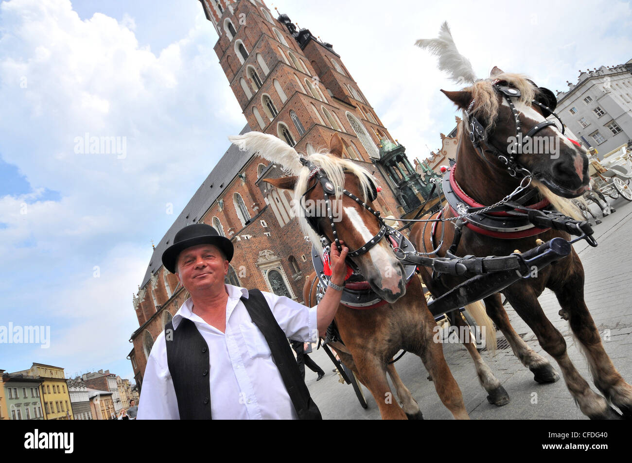 Coach at main market with cloth hall and Church of our Lady, Krakow, Poland, Europe Stock Photo