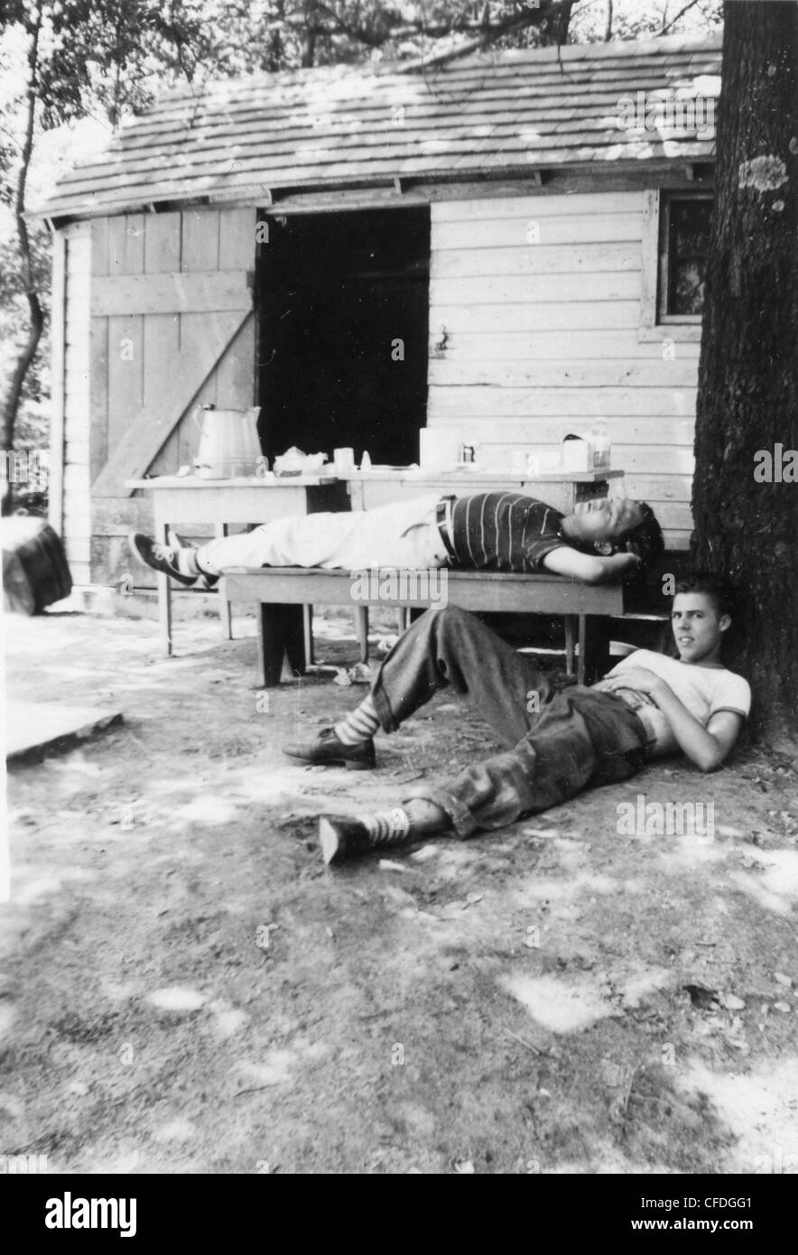 brothers hanging out next to homestead house 1930s 1940s United States America - Stock Image