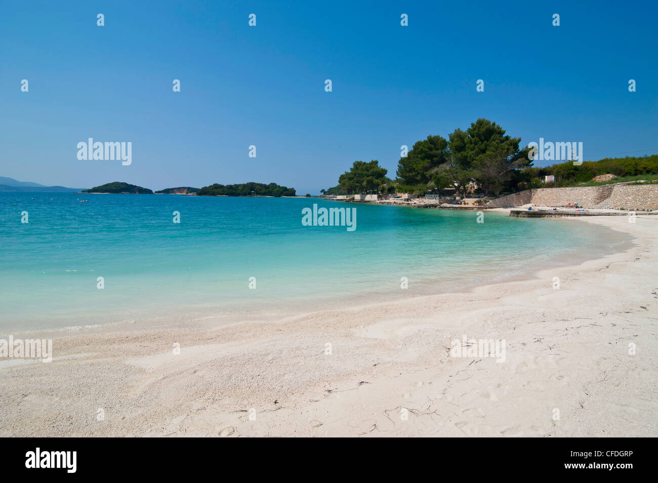 White sand beach and turquoise water at Ksamil, Albania, Europe - Stock Image