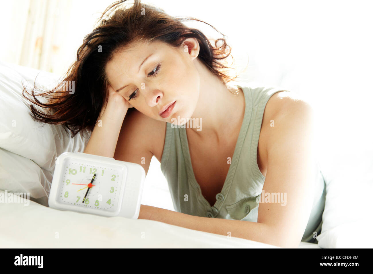 woman looking at clock stock photo 43939524 alamy