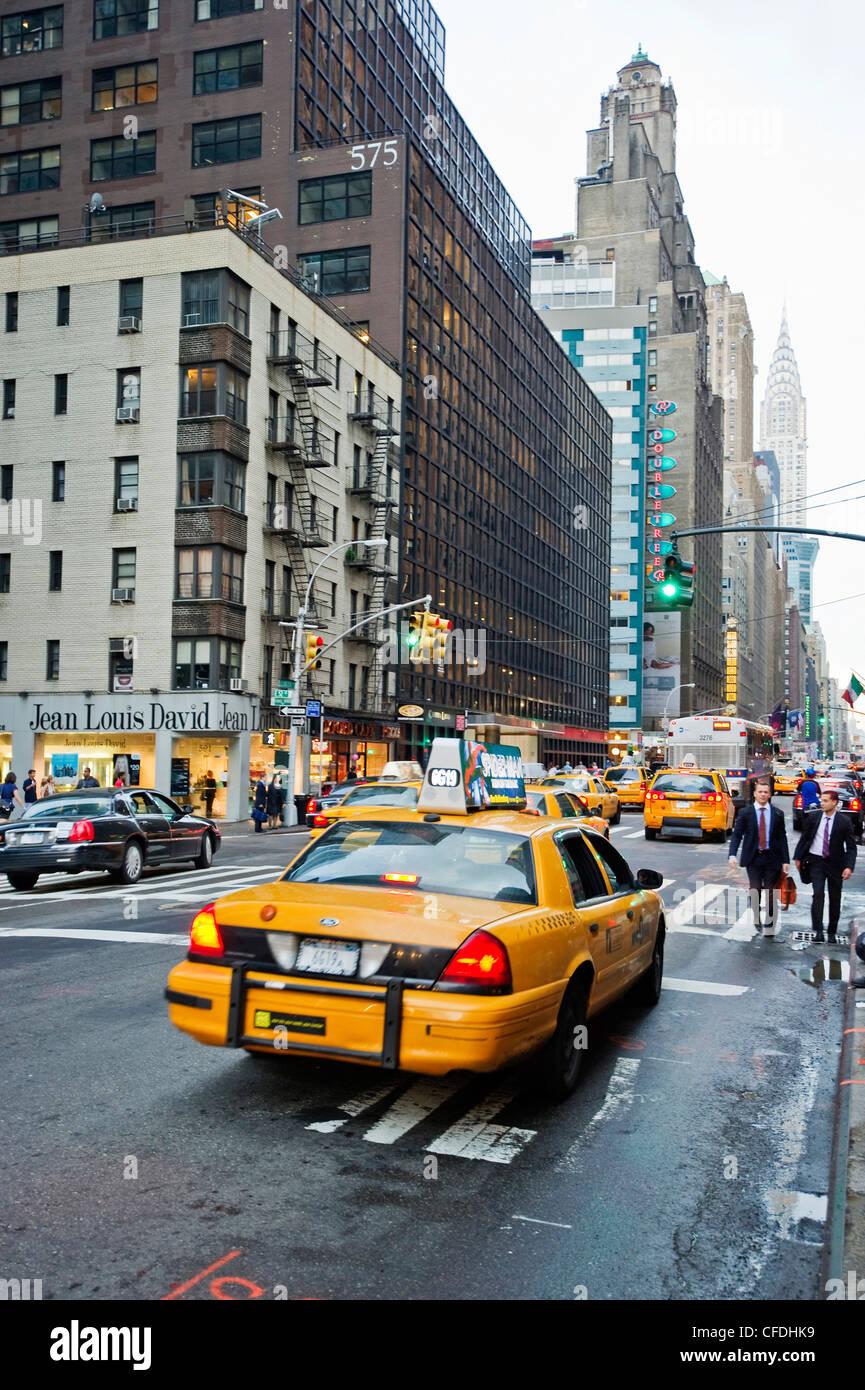 Busy Lexington Avenue, Chrysler Building in background, Manhattan, New York City, New York, USA - Stock Image
