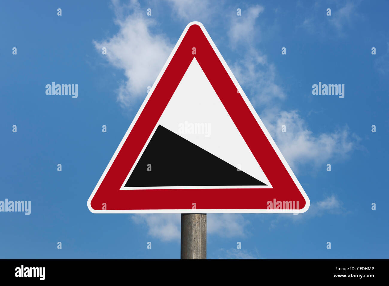 Detail photo of a danger sign 'Steep hill downwards' without inscription, background sky. - Stock Image