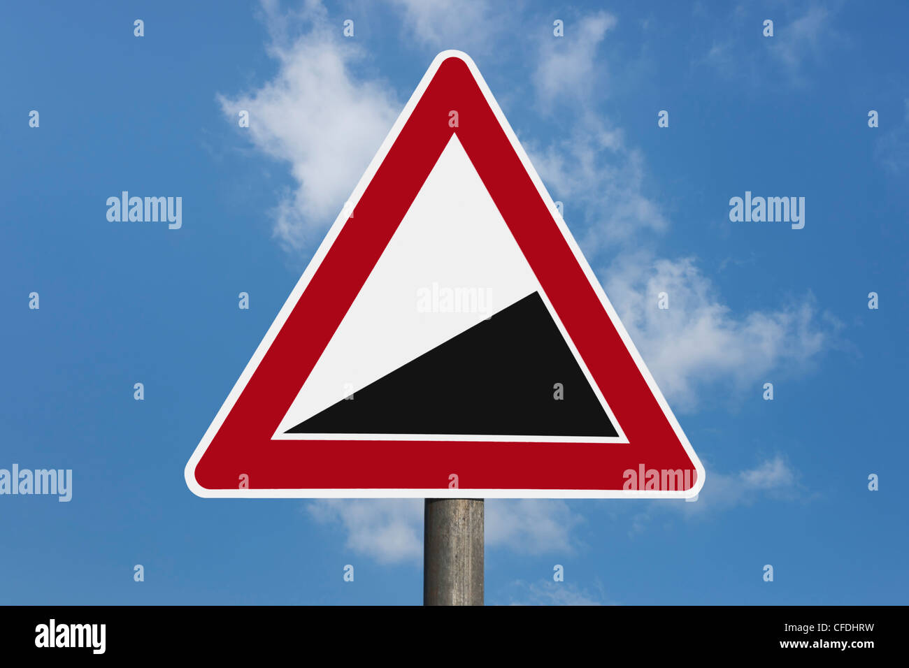 """Detail photo of a danger sign """"Upward gradient"""" without inscription, background sky. Stock Photo"""