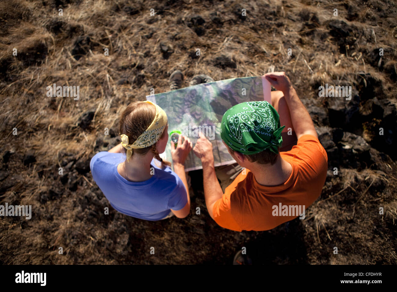 Couple using a map while out backpacking. - Stock Image