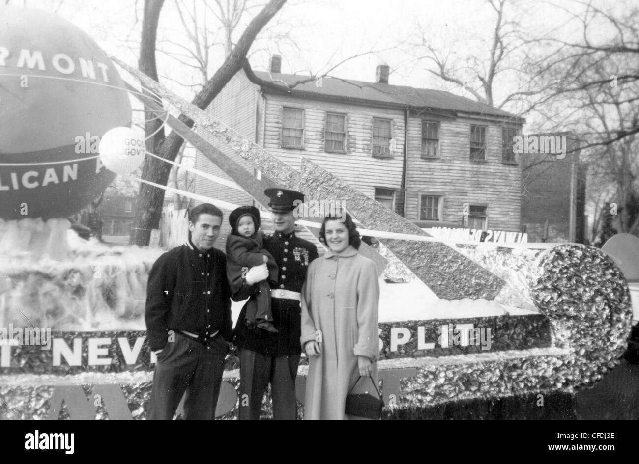 Decorated WWII veteran of the US marines at 1940s parade in Vermont veterans day posing with family - Stock Image